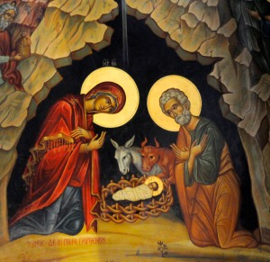 Mary and Joseph kneel at the crib of the infant Christ in this detail of an icon from the Church of the Nativity in Bethlehem. The Dec. 25 Christmas feast commemorates the birth of Christ. The Christmas season begins with the Dec. 24 evening vigil and ends on the feast of the Baptism of the Lord, Jan. 13 in 2008. (CNS photo/Debbie Hill) (Nov. 27, 2007)